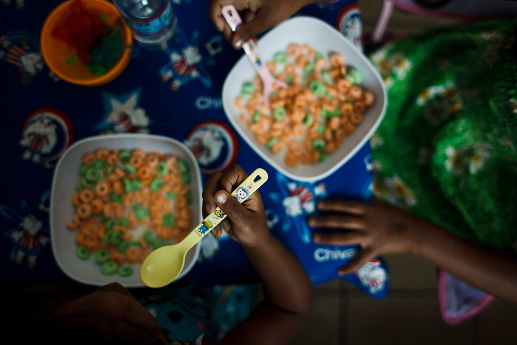 . Clarissa Taitano\'s daughters, A\'Riyah Jackson, 5, right, and I\'Yannah Jackson, 3, eat their breakfast in the morning on May 24, 2013, in San Jose. The family recently moved to their mobile home after living in a Santa Clara motel for 64 days. (Dai Sugano/Bay Area News Group)