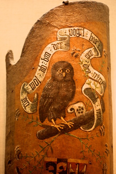 """At the Metropolitan Museum of Art. """"Jousting targe The target bears the arms of the Tansel and Rindscheit families and the inscription WIE WOL ICH BIN DER VOGEL HAS NOCH DEN ERFRET MICH DAS; Though I am hated by all birds, I nevertheless rather enjoy that. Wood, pigskin, burlap, gesso, paint. Hungarian, ca 1500"""""""