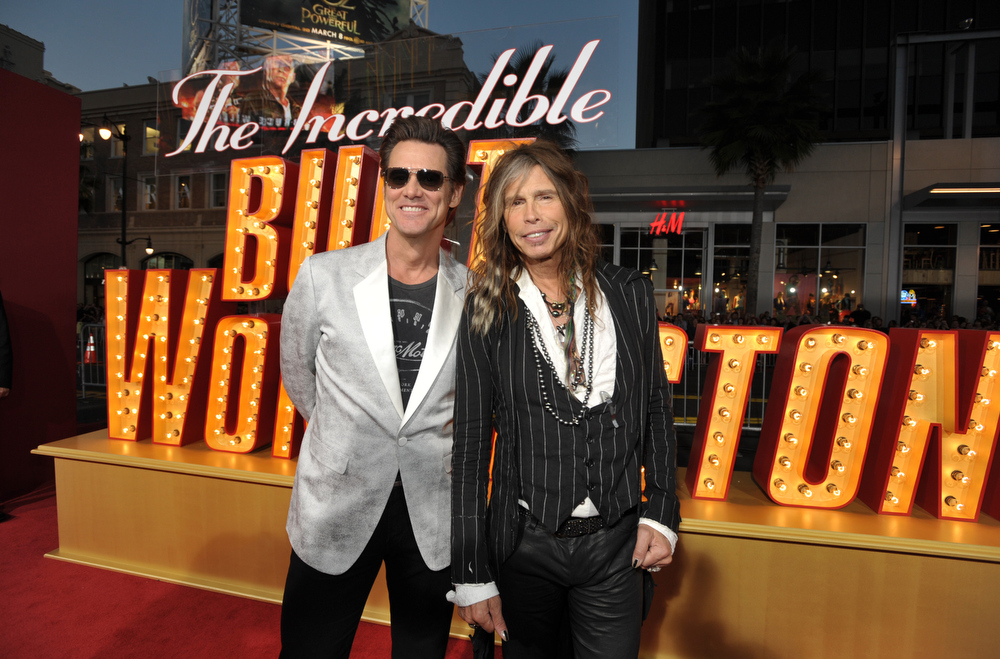 ". Actor Jim Carrey, left, and musician Steven Tyler arrive at the LA premiere of ""The Incredible Burt Wonderstone\"" at the TCL Chinese Theatre on Monday, March 11, 2013, in Los Angeles. (Photo by John Shearer/Invision/AP)"
