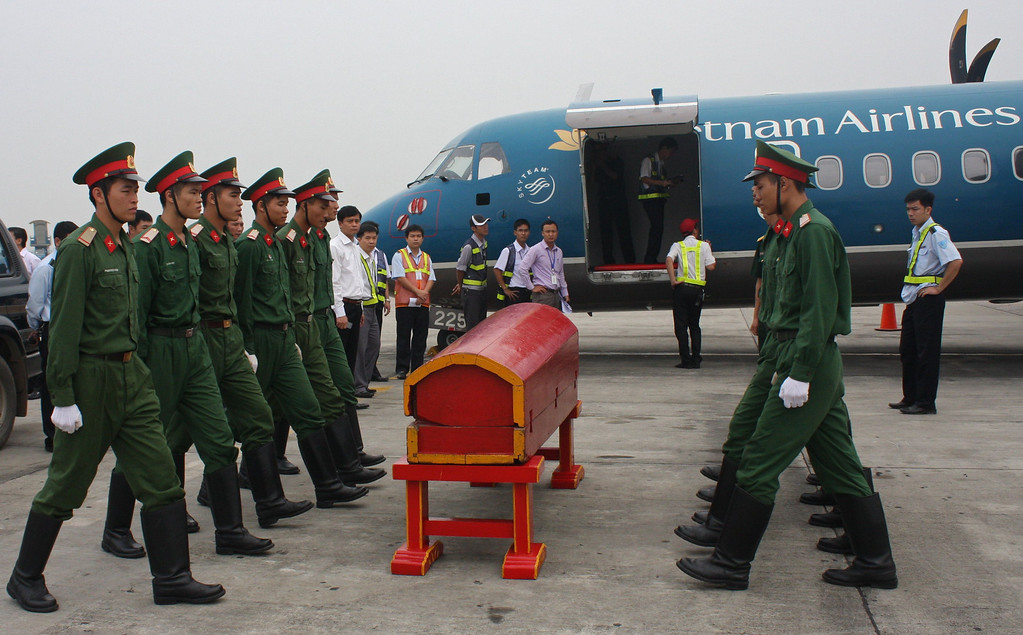 . This handout picture taken by Vietnam Airlines on October 9, 2013 shows soldiers doing a rehearsal of carrying a coffin in and out of a ATR72 aircraft at Hanoi airport as preparations are underway for the official funerals and burial service of the late General Vo Nguyen Giap which will take place over the weekend.  VIETNAM AIRLINES/AFP/Getty Images