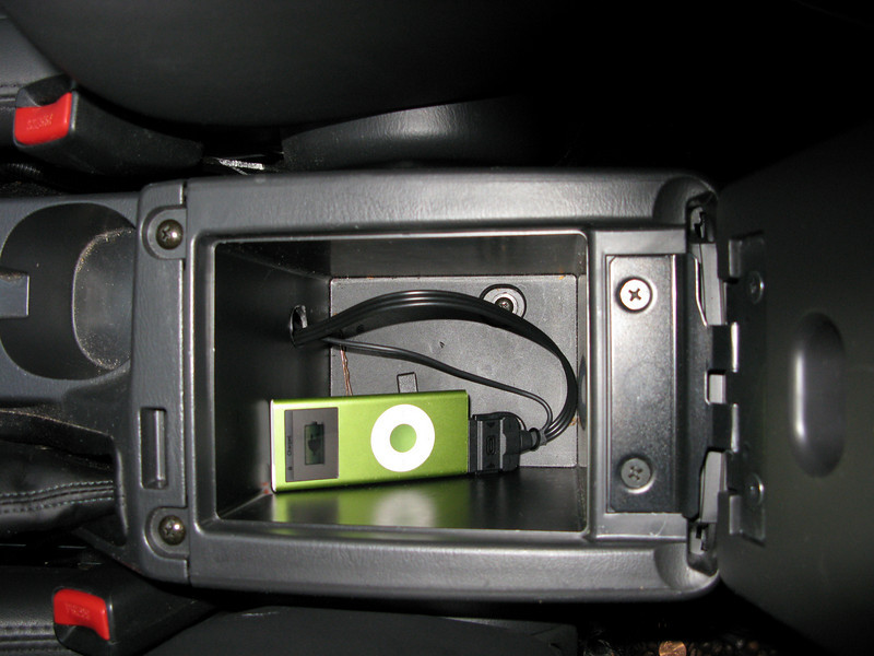 iPod cable in the storage area under the armrest.