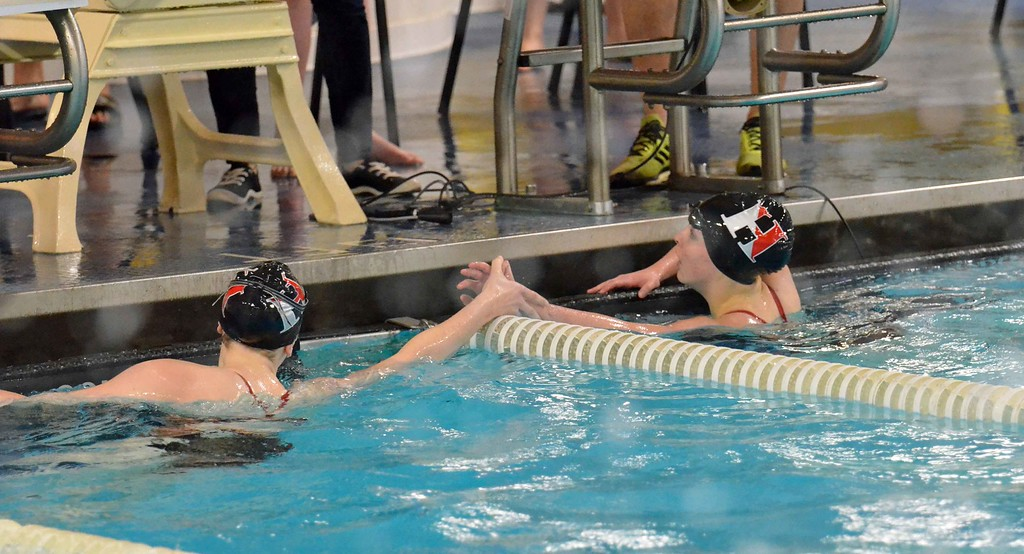 . Paul DiCicco - The News-Herald Hawken\'s Spencer Crawford, left, congratulates teammate Claire Pophal after her 200 free win.