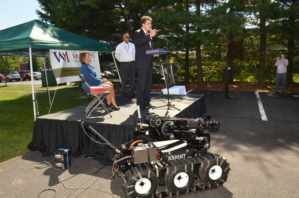 . Representative (R-PA 8th District)  Mike  Fitzpatrick speaks during ceremony at WM Robots LLC in Colmar.  At left is Montgomery County Disrict Attorney Risa Ferman with WM Robot Chief Operating officer Gene Samsi.   Thursday, August 28, 2014.  Photo by Geoff Patton