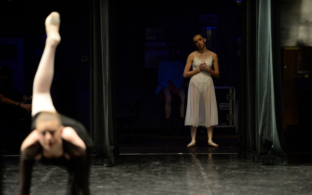 . 14-year-old Caroline Walton, right, watches and waits to perform from the backstage wings  as she was one of hundreds of ballet dancers that came to The Theater at Colorado Heights University in Denver to compete in the Youth America Grand Prix Regional semi-finals   on Friday, February 19, 2016.  The weekend competition was for dancers to earn scholarships and invitations to dance companies.    (Photo by Cyrus McCrimmon/ The Denver Post)