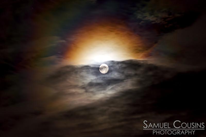 A colorful corona around the moon.