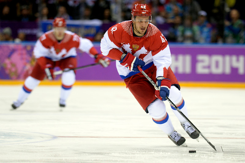 . Artyom Anisimov (42) of the Russia controls the puck against the U.S.A. during the second period of men\'s hockey action at Bolshoy arena. Sochi 2014 Winter Olympics on Saturday, February 15, 2014. (Photo by AAron Ontiveroz/The Denver Post)