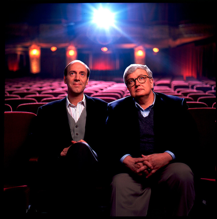 . In this undated photo released by Disney-ABC Domestic Television, movie critics Roger Ebert, right, and Gene Siskel are shown. Starting Thursday, Aug. 2, 2007, a new web site touted as the largest collection of video-based movie reviews online will begin. The site will feature clips from the show that made the thumb famous and include 5,000 movie reviews, spanning more than 20 years of the show hosted by newspaper film critics Roger Ebert and the late Gene Siskel and columnist Richard Roeper. (AP Photo/Disney-ABC Domestic Television)