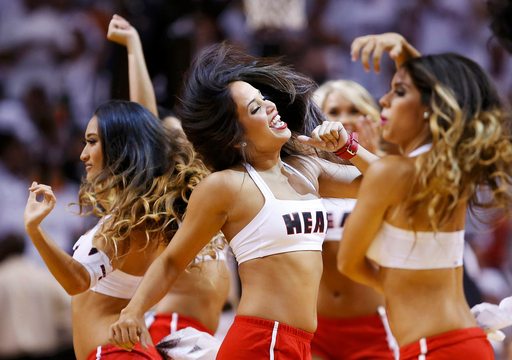 . Miami Heat cheerleaders perform during a break in play as the Heat play the San Antonio Spurs during Game 1 of their NBA Finals basketball playoff in Miami, Florida June 6, 2013. REUTERS/Mike Segar