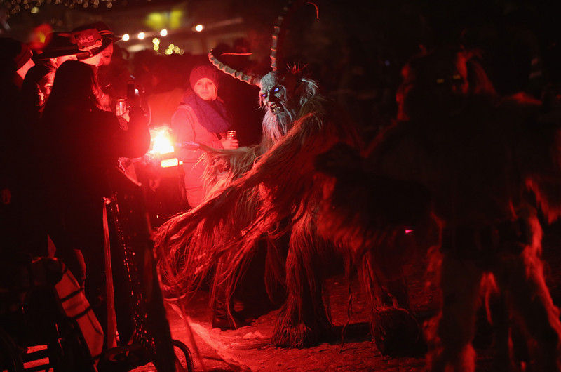 . A participant dressed as the Krampus creature confronts onlookers during his search for delinquent children during Krampus night on November 30, 2013 in Neustift im Stubaital, Austria. Sixteen Krampus groups including over 200 Krampuses participated in the first annual Neustift event. Krampus, in Tyrol also called Tuifl, is a demon-like creature represented by a fearsome, hand-carved wooden mask with animal horns, a suit made from sheep or goat skin and large cow bells attached to the waist that the wearer rings by running or shaking his hips up and down. Krampus has been a part of Central European, alpine folklore going back at least a millennium, and since the 17th-century Krampus traditionally accompanies St. Nicholas and angels on the evening of December 5 to visit households to reward children that have been good while reprimanding those who have not. However, in the last few decades Tyrol in particular has seen the founding of numerous village Krampus associations with up to 100 members each and who parade without St. Nicholas at Krampus events throughout November and early December.  (Photo by Sean Gallup/Getty Images)