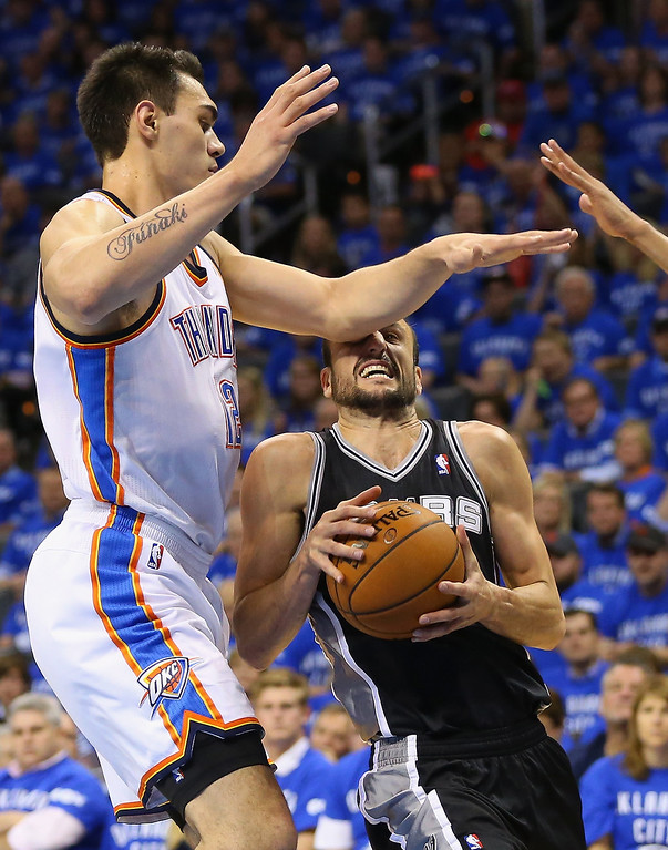 . OKLAHOMA CITY, OK - MAY 25: Steven Adams #12 of the Oklahoma City Thunder hits Manu Ginobili #20 of the San Antonio Spurs in the face in the first half during Game Three of the Western Conference Finals of the 2014 NBA Playoffs at Chesapeake Energy Arena on May 25, 2014 in Oklahoma City, Oklahoma.  (Photo by Ronald Martinez/Getty Images)
