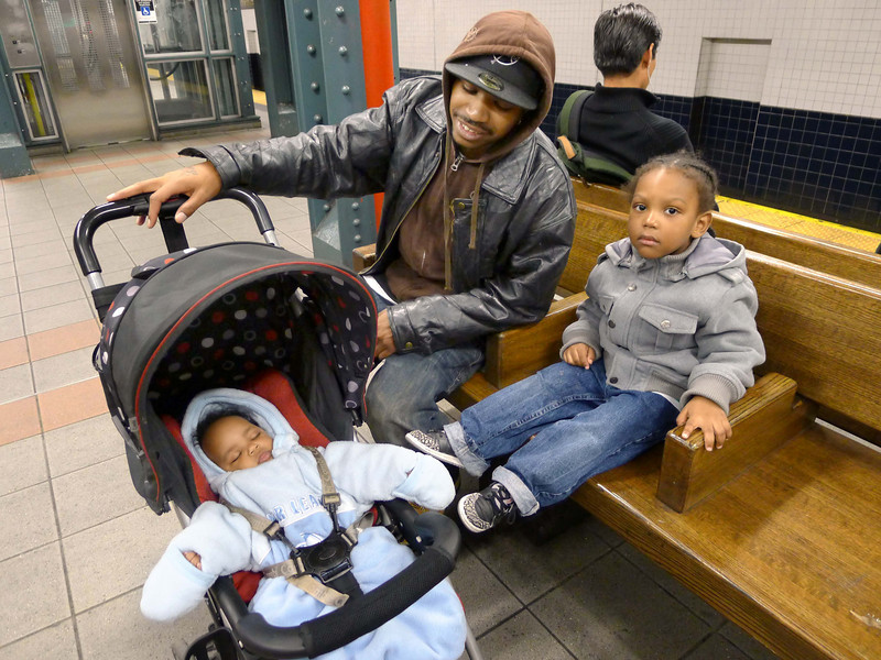 Met this man and his little kids Oct. 15, 2010, on the Myrtle Avenue station of the 14th Street - Canarsie line (the L train).  The kids are cute as cap pistols.  He caught my attention as he was telling his little girl not to point!  That's what they used to do with me in the old, old days.