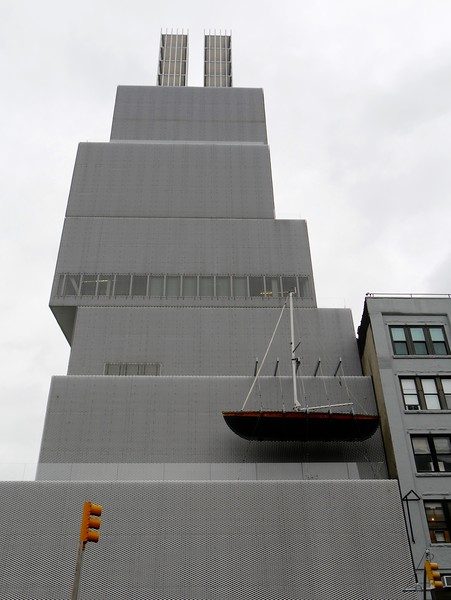 """""""Ghost Ship"""" by artist Chris Burden suspended from the side of the New Museum, intended to read as a lifeboat on the side of the Titanic"""