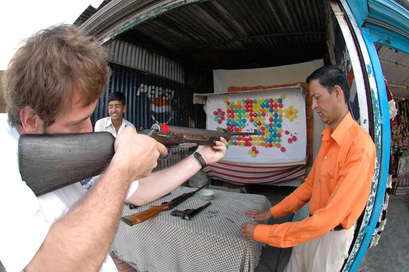 Mussoorie: Jon Deutsch shoots balloons with a pellet gun.