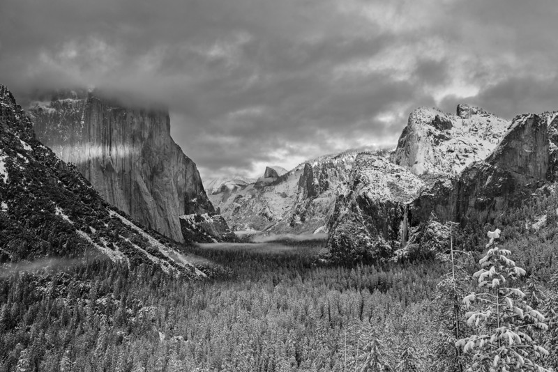 Black and white version of the scene at Yosemite. Fog rolls into the valley.