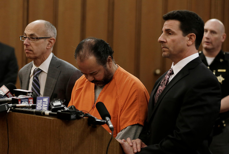 . Ariel Castro, center, stands before a judge with his defense attorney\'s, Jaye Schlachet, left, and Craig Weintraub during his arraignment Wednesday, June 12, 2013, in Cleveland. Castro, who held 3 women captive for a decade, has committed suicide, Tuesday, Sept. 3, 2013. (AP Photo/Tony Dejak)