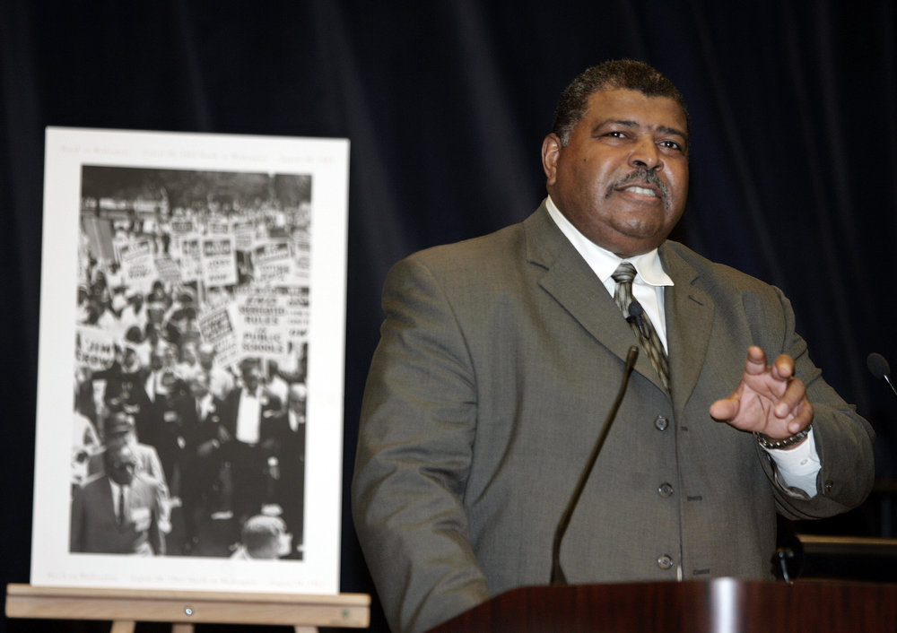 Description of . Cleveland Browns head coach Romeo Crennel gestures during a program celebrating African American History month at the State Department on Friday, Feb. 18, 2005 in Washington.   (AP Photo/Evan Vucci)