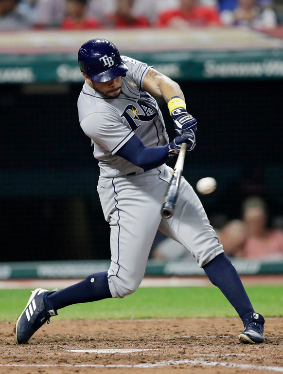 . Tampa Bay Rays\' Tommy Pham hits a one-run double in the sixth inning of a baseball game against the Cleveland Indians, Saturday, Sept. 1, 2018, in Cleveland. (AP Photo/Tony Dejak)