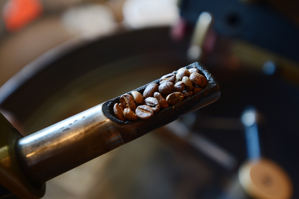 . Beans are checked for color as a batch of Lola blend coffee is roasted at the Catahoula Coffee Company in Richmond, Calif. on Thursday, Jan. 17, 2013. (Kristopher Skinner/Staff)