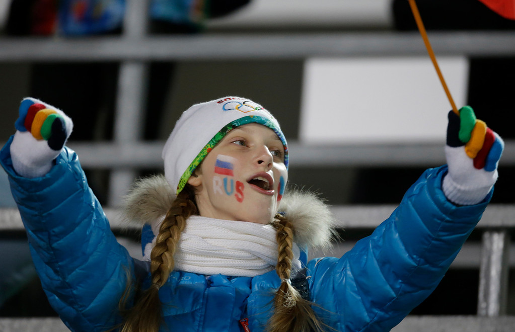 . A fan cheers prior to the men\'s normal hill ski jumping final at the 2014 Winter Olympics, Sunday, Feb. 9, 2014, in Krasnaya Polyana, Russia. (AP Photo/Gregorio Borgia)