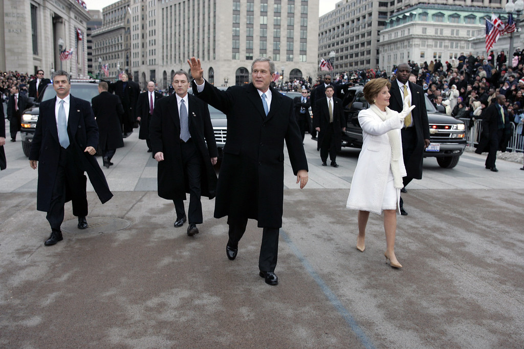. President Bush and first lady Laura Bush walk during the inauguration parade in front of the White House. Thursday, Jan. 20, 2005, in Washington. (AP Photo/Doug Mills/Pool)