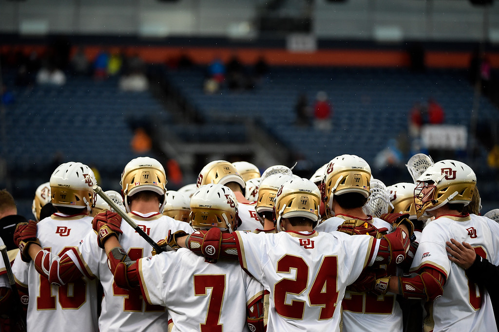 . Denver Pioneers gather in the final minute against Ohio State Buckeyes during the second half of Denver\'s 15-13 NCAA tournament quarterfinal win. The Denver Pioneers played the Ohio State Buckeyes at Sports Authority field at Mile High on Saturday, May 16, 2015. (Photo by AAron Ontiveroz/The Denver Post)