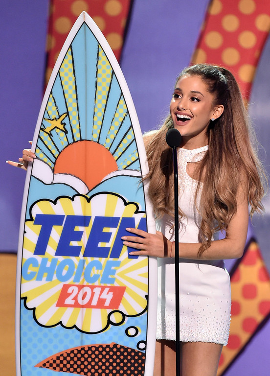 . Recording artist Ariana Grande, winner of Best Female Artist onstage during FOX\'s 2014 Teen Choice Awards at The Shrine Auditorium on August 10, 2014 in Los Angeles, California.  (Photo by Kevin Winter/Getty Images)