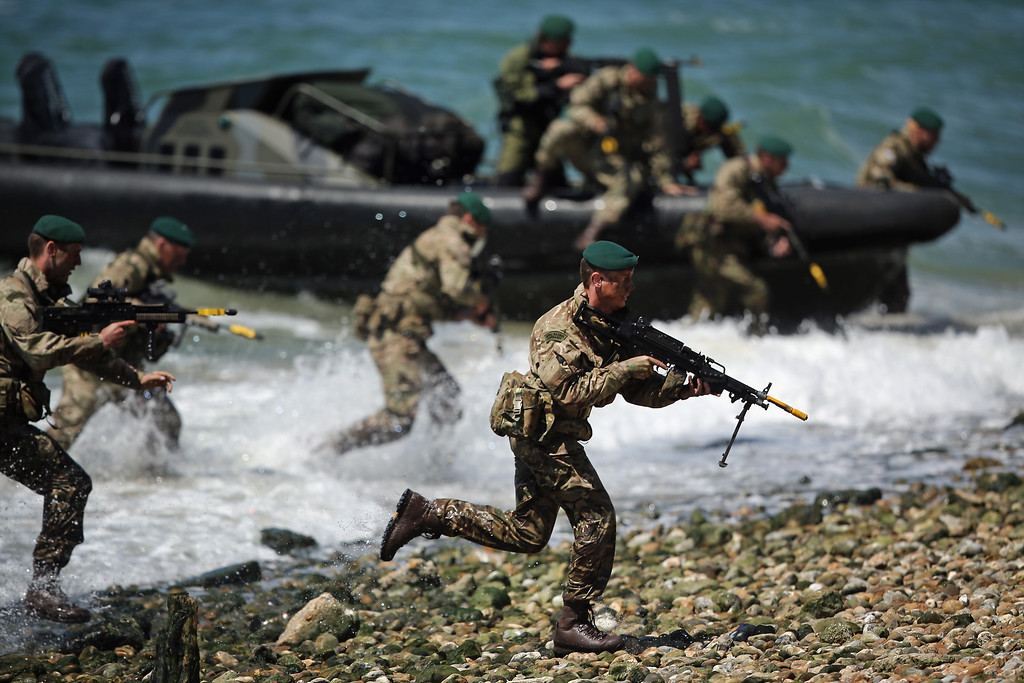 . Members of the Royal Marines take part in an amphibious display on Southsea Beach as part of the commemoration of the D-day landings on June 5, 2014 in Portsmouth, England.  (Photo by Dan Kitwood/Getty Images)