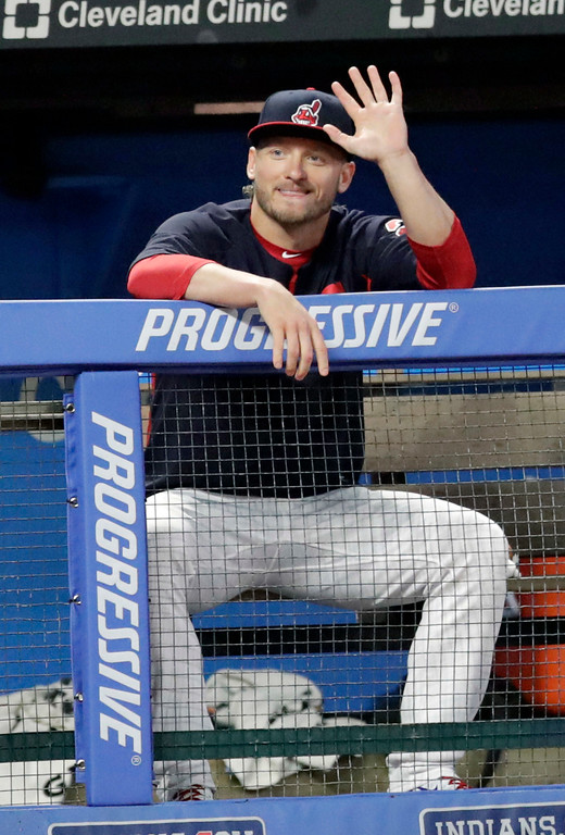 . Cleveland Indians\' Josh Donaldson waves after arriving in Cleveland as he watches the Indians play the Tampa Bay Rays in the fifth inning of a baseball game, Saturday, Sept. 1, 2018. Josh Donaldson experienced flight issues from Florida on his first official day as a member of the Indians. The 2015 AL MVP was not expected to reach Progressive Field until game-time Saturday night, a day after Cleveland acquired the free-swinging third baseman in a trade with Toronto � a deal the AL Central leaders hope propels them to the World Series. (AP Photo/Tony Dejak)