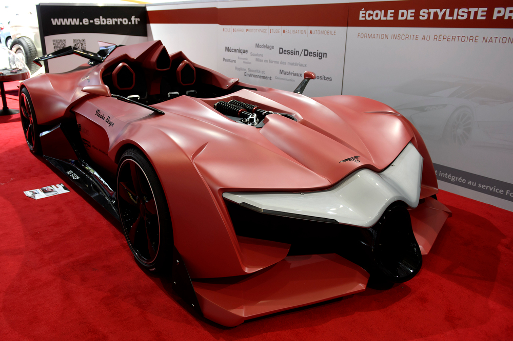 . The new concept car Sbarro Fleche Rouge is shown during the press day at the 84th Geneva International Motor Show in Geneva, Switzerland, Wednesday, March 5, 2014. (AP Photo/Keystone, Martial Trezzini)