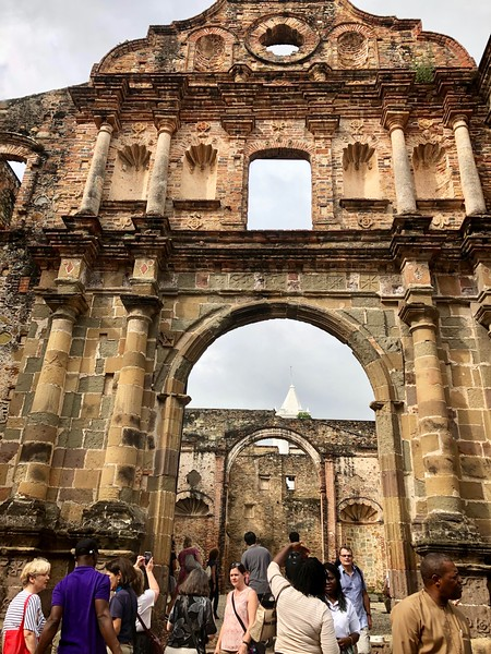 Tourists looking at building ruins in Panama.