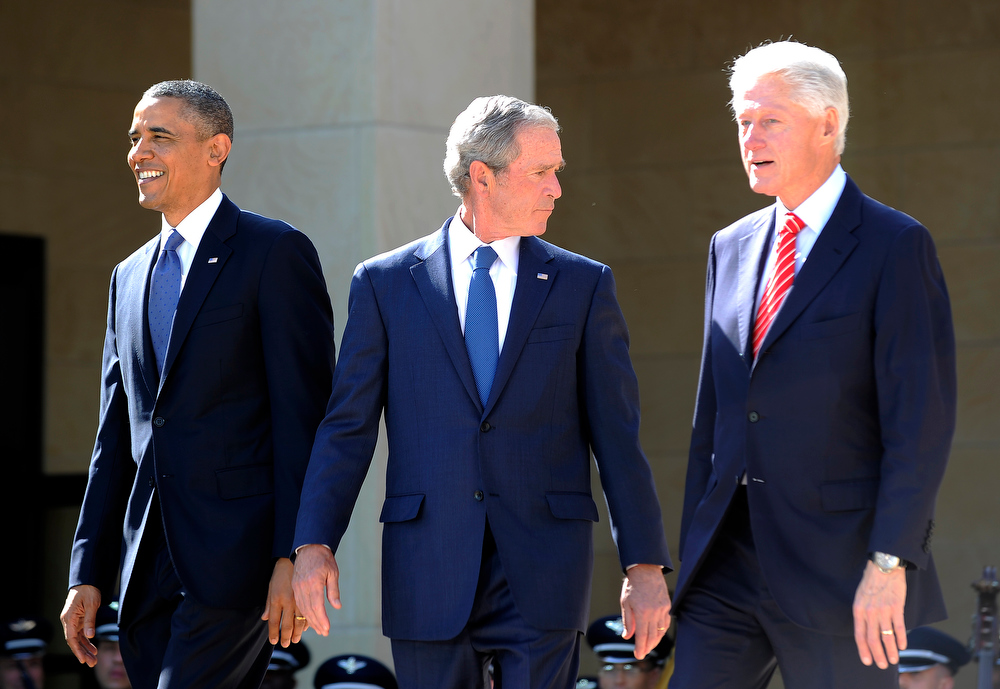 Description of . US President Barack Obama (L) and former US Presidents George W. Bush (C) and Bill Clinton arrive on stage for the George W. Bush Presidential Center dedication ceremony in Dallas, Texas, on April 25, 2013.  JEWEL SAMAD/AFP/Getty Images