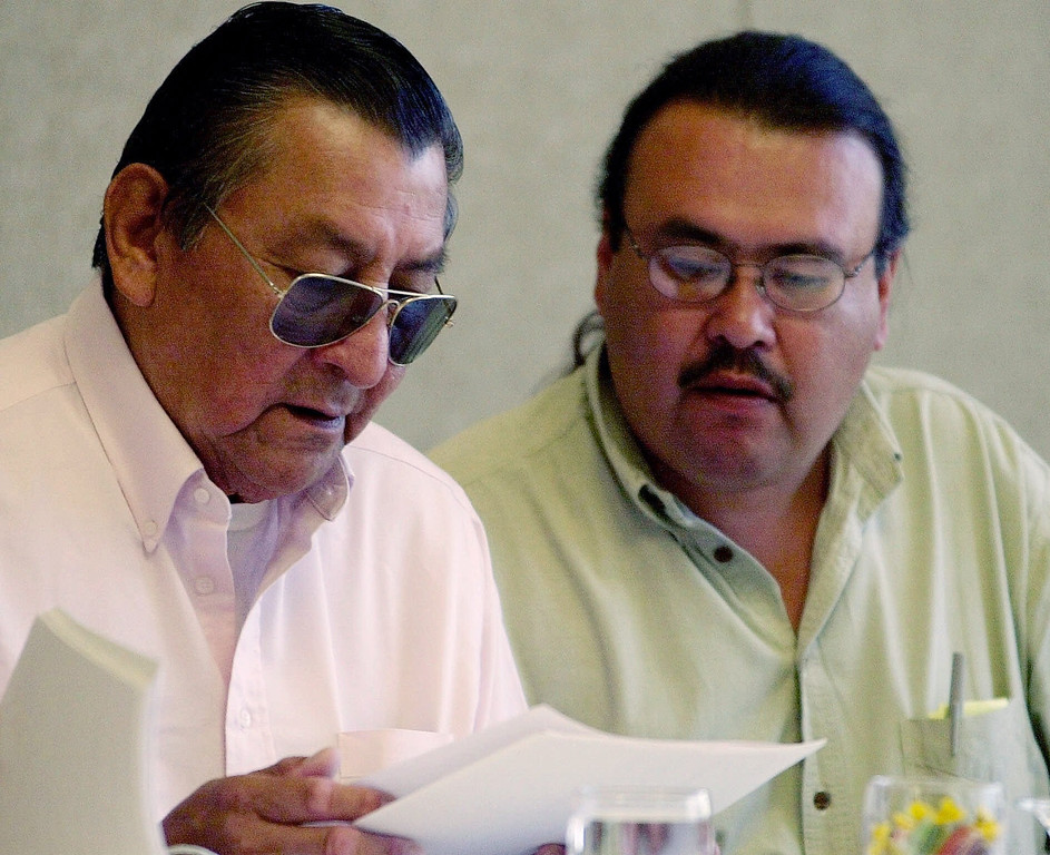 . Southern Cheyenne Chief Laird Cometsevah, left, and Steve Brady, a Northern Cheyenne Headsman who is president of Sand Creek Descendants of the Northern Cheyenne, review records during a meeting in Denver, Thursday, June 8, 2000, with representatives of the National Park Service concerning the Sand Creek Massacre. A year after researchers confirmed the location of the massacre, the National Park Service is recommending the area be declared a national historic site.  (AP Photo/Ed Andrieski)