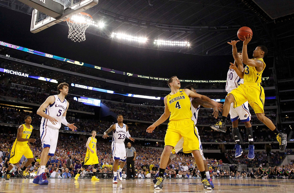 . Michigan Wolverines guard Trey Burke shoots against the Kansas Jayhawks during overtime in their South Regional NCAA men\'s basketball game in Arlington, Texas March 29, 2013. REUTERS/Jim Young