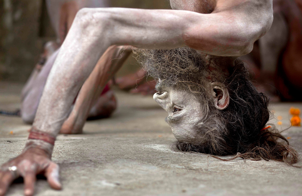 . An Indian Sadhu or Hindu holy man performs Yoga to mark International Yoga Day at Kamakhya temple in Gauhati, India, Wednesday, June 21, 2017. Millions of yoga enthusiasts across India take part in a mass yoga sessions to mark the third International Yoga Day which falls on June 21 every year. (AP Photo/ Anupam Nath)