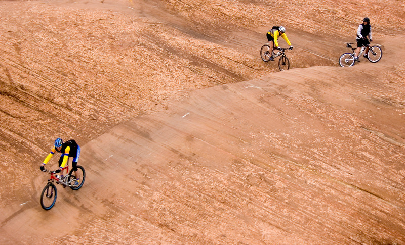 Mountain biking legend Gary Fisher leads Trek Travel guests on the Slickrock trail outside of Moab, UT.