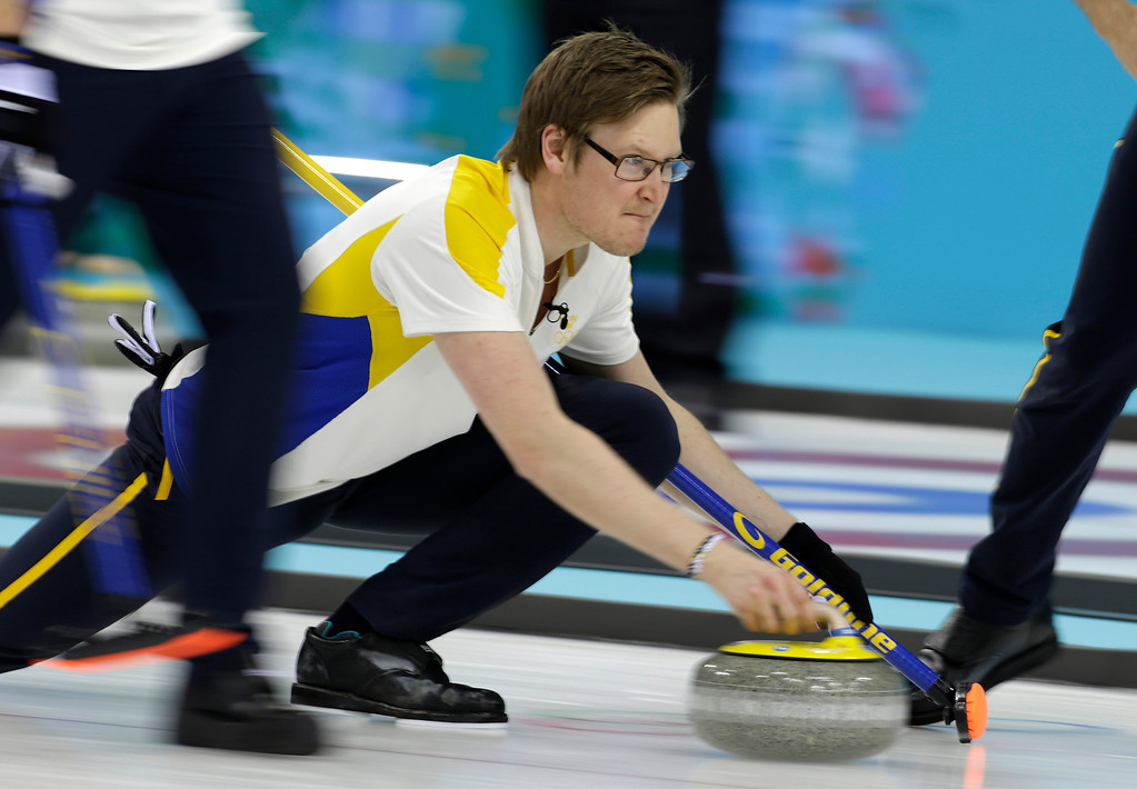 . Swedenís Viktor Kjaell delivers the rock during men\'s curling competition against Norway at the 2014 Winter Olympics, Thursday, Feb. 13, 2014, in Sochi, Russia. (AP Photo/Robert F. Bukaty)