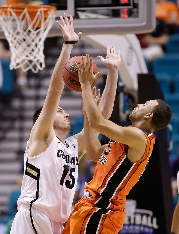 . Oregon State\'s Roberto Nelson (55) is fouled by Colorado\'s Shane Harris-Tunks while shooting in the second half during a Pac-12 tournament NCAA college basketball game on Wednesday, March 13, 2013, in Las Vegas. Colorado won 74-68. (AP Photo/Julie Jacobson)