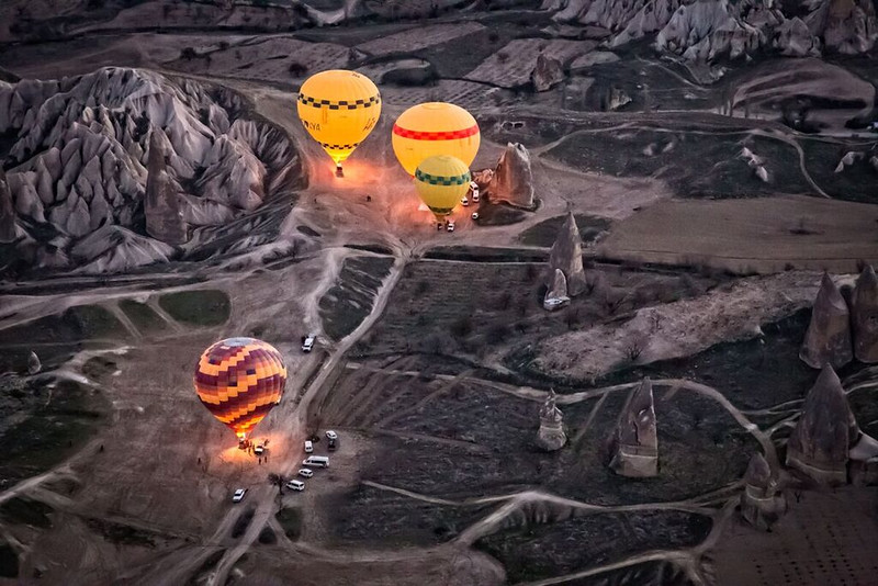 Yellow balloons glowing in the sky at sunrise