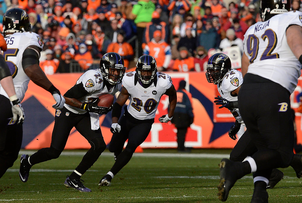 Description of . Baltimore Ravens cornerback Corey Graham (24) pulls in an interception in the first quarter. The Denver Broncos vs Baltimore Ravens AFC Divisional playoff game at Sports Authority Field Saturday January 12, 2013. (Photo by Joe Amon,/The Denver Post)