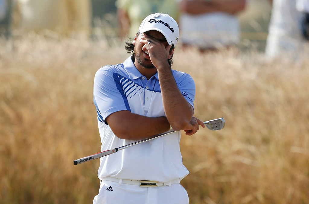 . Jason Day of Australia reacts on the 17th green during the third round of the British Open Golf Championship at Muirfield, Scotland, Saturday July 20, 2013. (AP Photo/Matt Dunham)