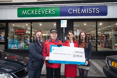 John Dalzell and James McCaffery from Southern Area hospice accept a cheque for £1095 from Ruth England and Bernie Byrnes at McKeevers Chemist. R1604001