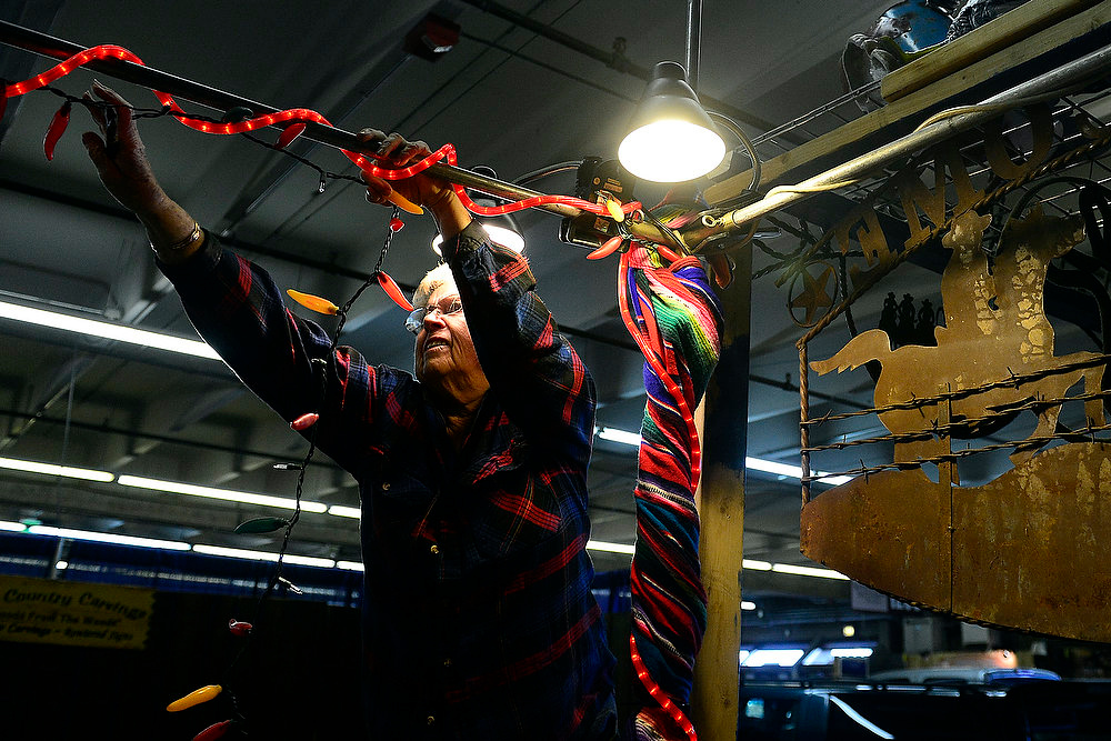 . Barbara Williams, of Cowboys Touch Pepper Jam, prepares her booth in preparation for the National Western Stock Show at the complex on Wednesday, January 9, 2012.