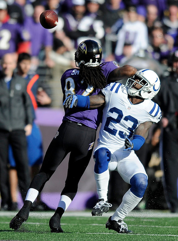 . Baltimore Ravens wide receiver Torrey Smith (82) can\'t make the catch as he is defended by Indianapolis Colts cornerback Vontae Davis (23) during the first half of an NFL wild card playoff football game Sunday, Jan. 6, 2013, in Baltimore. (AP Photo/Nick Wass)