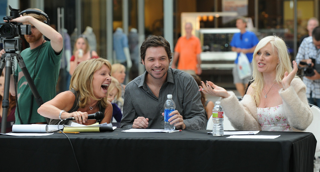 """. Judges (L-R) producer/director Bonnie Lythgoe, Michael Johns from \""""American Idol\"""" and actress Charley King during the talent search for the next \""""Cinderella\"""" at Culver City in Los Angeles on July 14, 2010.  The winner of the search will appear as the lead in \""""Cínderella, A Modern Magical Musical Extravaganza\"""" that will be produced by Nigel, Bonnie, and Kris Lythgoe, who also produce \""""So You Think You Can Dance\"""", \""""Dancing With The Stars\"""" and \""""American Idol\"""".               (MARK RALSTON/AFP/Getty Images)"""