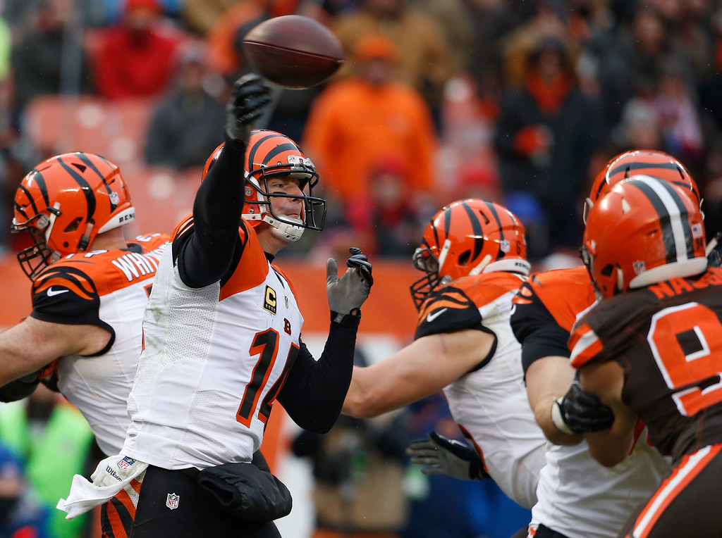 . Cincinnati Bengals quarterback Andy Dalton (14) passes in the second half of an NFL football game against the Cleveland Browns, Sunday, Dec. 11, 2016, in Cleveland. (AP Photo/Ron Schwane)