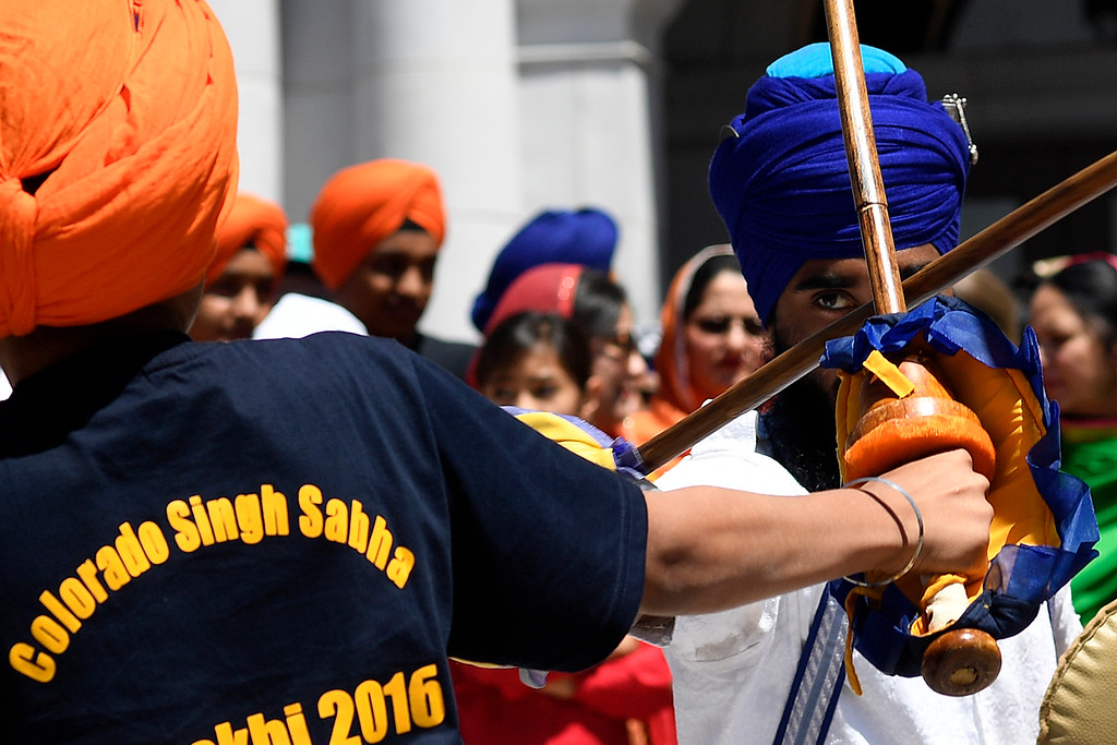 . DENVER, CO - MAY 22: Guru Raja Khalsa partakes in gatka � a traditional form of martial art � with an opponent on Sunday, May 22, 2016. This was Denver\'s first ever Sikh parade. The event was held to celebrate the culture of the growing Sikh population in the area. (Photo by AAron Ontiveroz/The Denver Post)