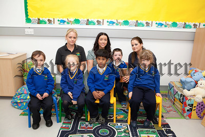 Teacher Helen Entwistle and Classroom Assistants Jennifer McGuigan and Aine Larkin are pictured with Primary 1 pupils at Rathore School during their First days at school. R1338015