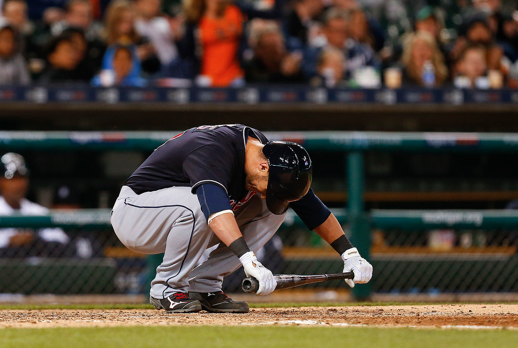 . Cleveland Indians\' Yan Gomes reacts after striking out against the Detroit Tigers in the eighth inning of a baseball game, Friday, April 22, 2016, in Detroit. (AP Photo/Paul Sancya)
