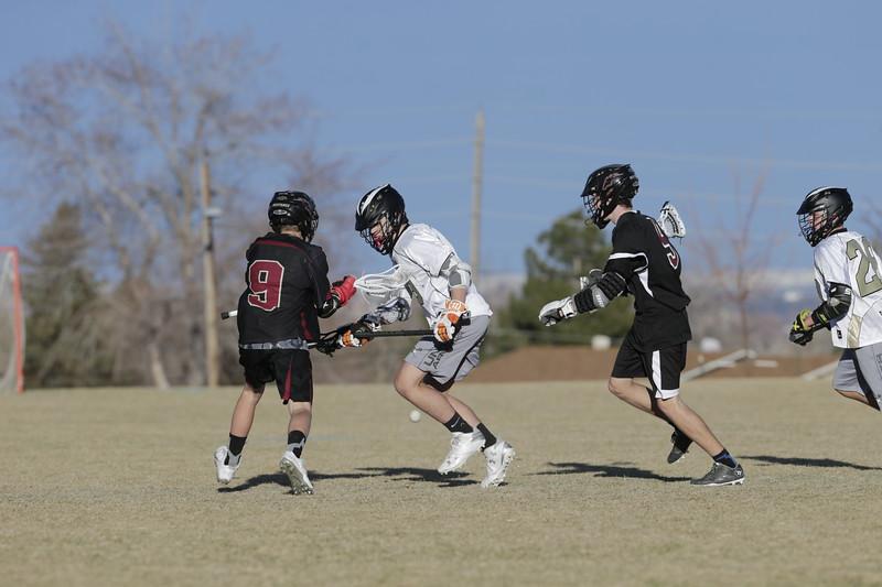 JPM0255-JPM0255-Jonathan first HS lacrosse game March 9th.jpg