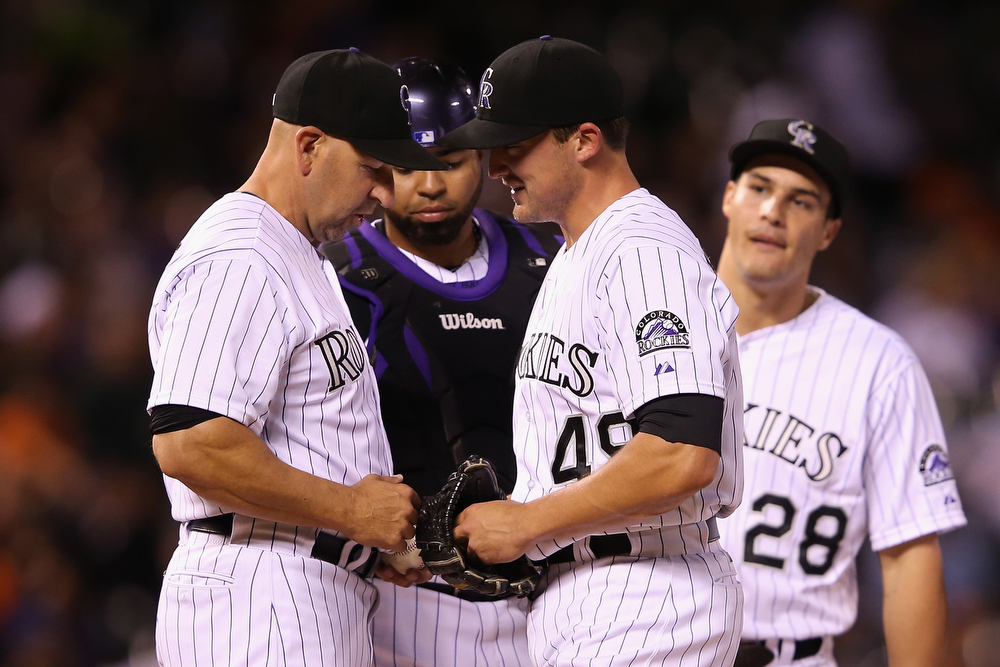 . Manager Walt Weiss #22 removes relief pitcher Rex Brothers #49 of the Colorado Rockies from the game against the San Francisco Giants in the ninth inning at Coors Field on April 22, 2014 in Denver, Colorado. The Rockies defeated the Giants 2-1.  (Photo by Doug Pensinger/Getty Images)